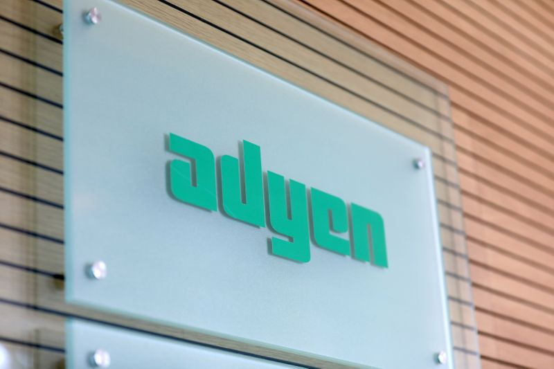 FILE PHOTO: The Adyen logo is seen at the reception desk of the company's headquarters in Amsterdam