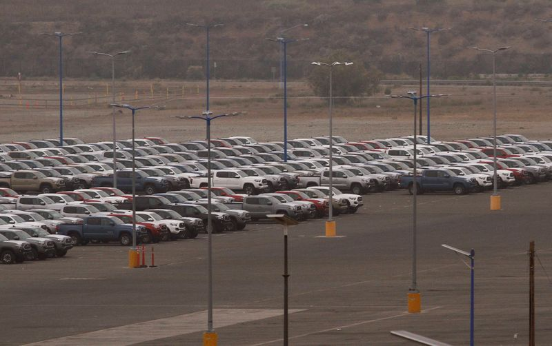 Newly assembled vehicles are parked at the Toyota Motor Manufacturing plant in Baja California
