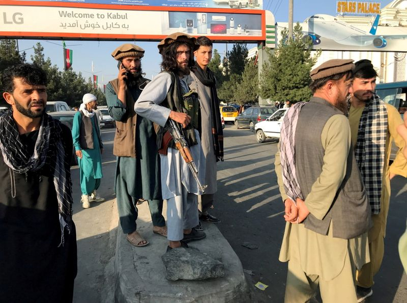 A member of Taliban stands outside Hamid Karzai International Airport in Kabul