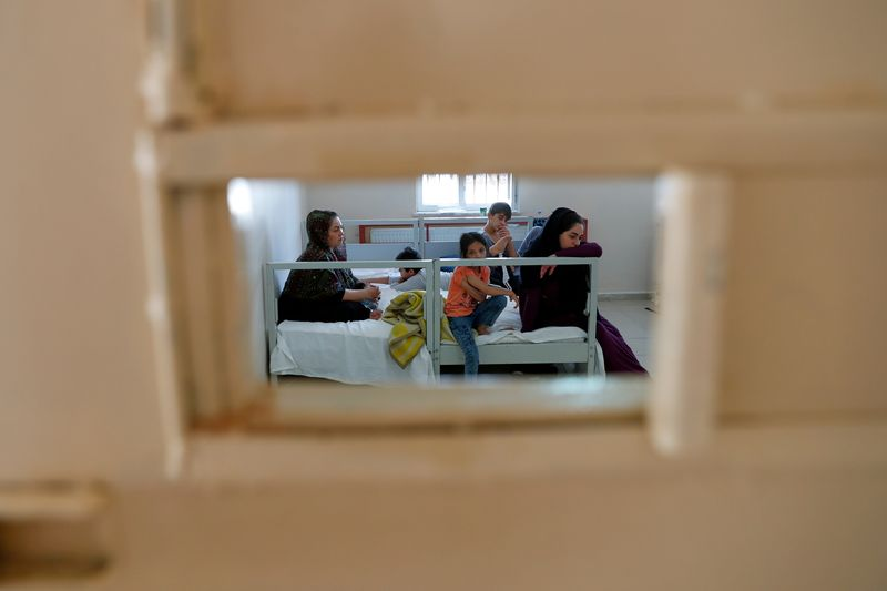A migrant family from Afghanistan is pictured at a migrant processing centre in Van