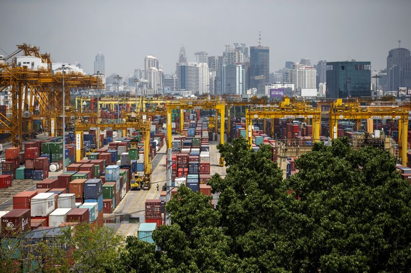 FILE PHOTO: Shipping containers stand at a port in Bangkok