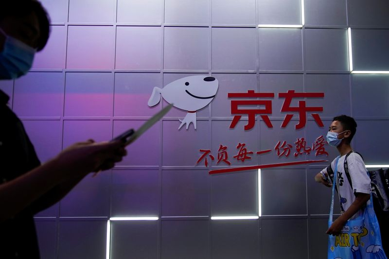 A sign of JD.com is seen at the China Digital Entertainment Expo and Conference, also known as ChinaJoy, in Shanghai