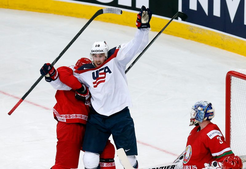 Hayes of the U.S. celebrates the goal of team mate Trouba against goalkeeper Mezin of Belarus during the second period of their men's ice hockey World Championship Group B game at Minsk Arena in Minsk
