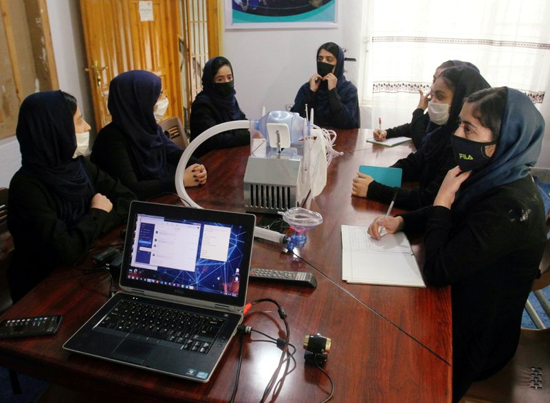 FILE PHOTO: Members of an Afghan all-female robotics team work on an open-source and low-cost ventilator in Herat
