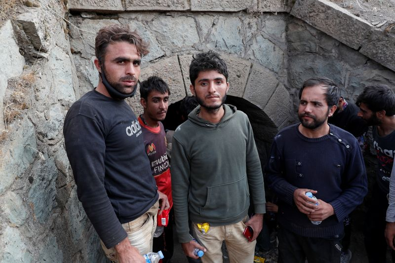 Migrants from Afghanistan hide from security forces after crossing illegally into Turkey from Iran, near Tatvan