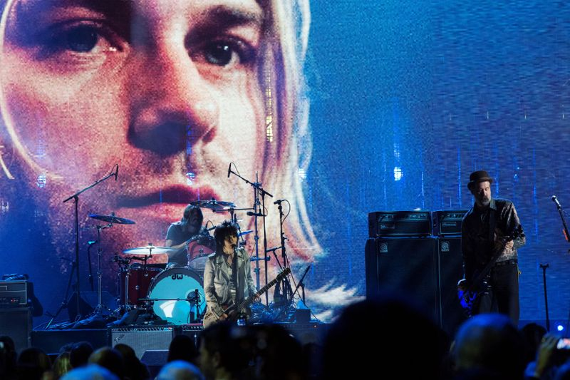 FILE PHOTO: The surviving members of Nirvana perform with Joan Jett in 2014