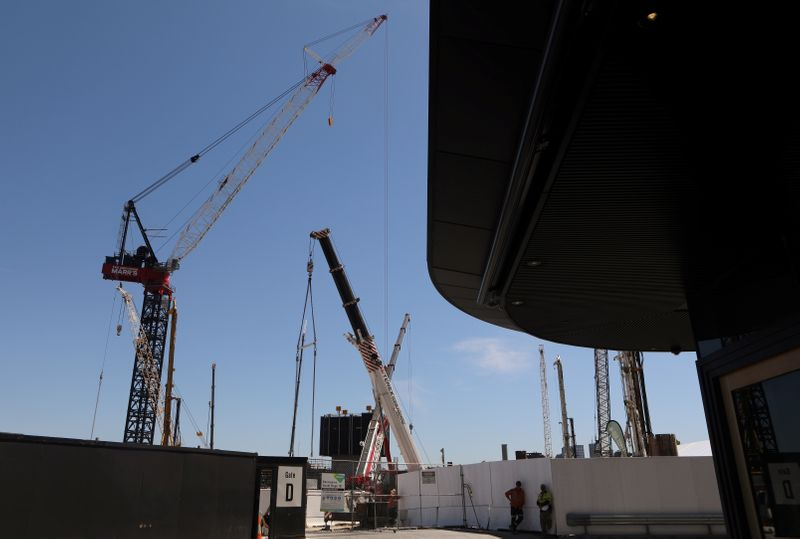 Construction cranes are seen at a construction site in central Sydney