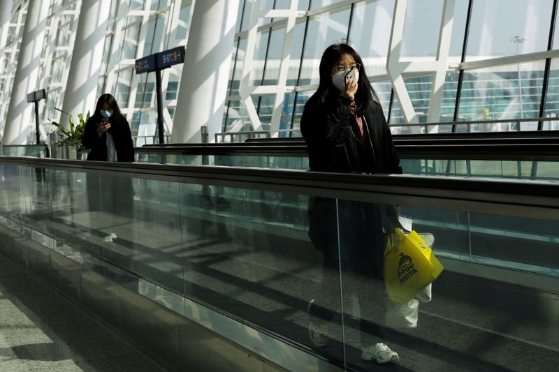 Travellers at Wuhan Tianhe International Airport