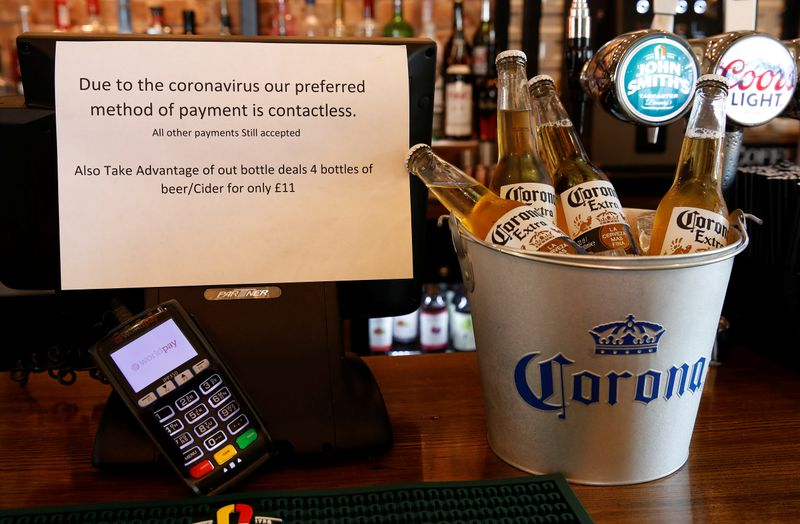 FILEPHOTO: A sign asking customers to only use contactless payment methods is seen in a pub in Liverpool, Britain