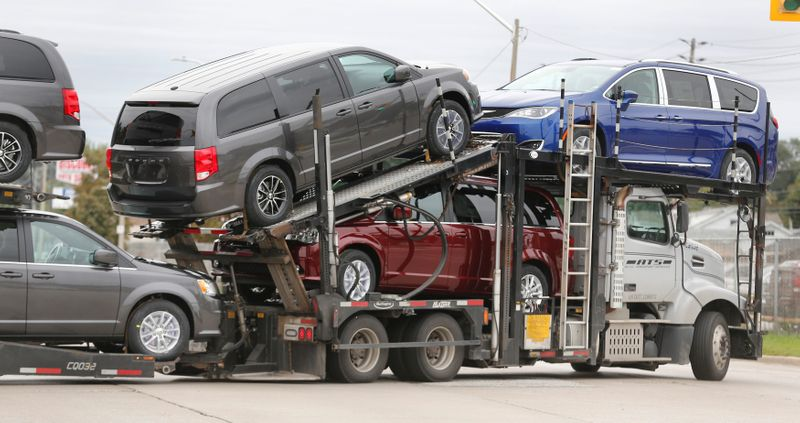Car hauler transports newly assembled vehicles from the FCA Windsor Assembly plant in Windsor, Ontario