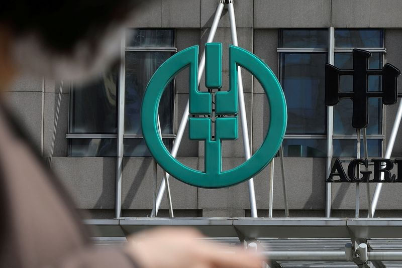 FILE PHOTO: Sign of Agricultural Bank of China is seen at its office building in Beijing