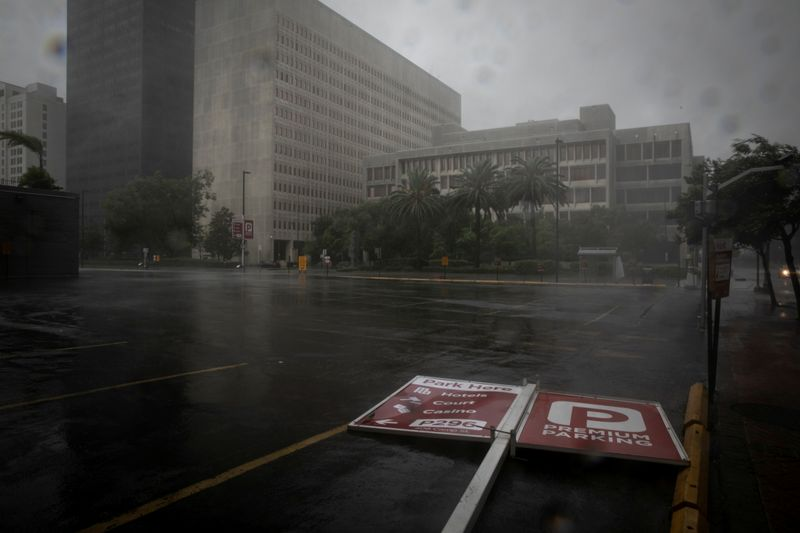 FILE PHOTO: A parking sign lies in the street as Hurricane Ida makes landfall in Louisiana, in New Orleans