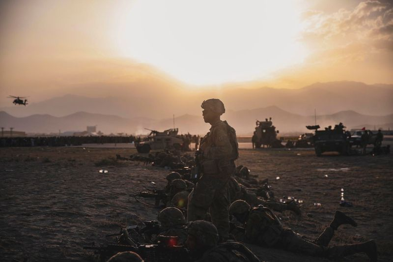 U.S. Army Soldiers assigned to the 10th Mountain Division stand security at Hamid Karzai International Airport, Kabul, Afghanistan