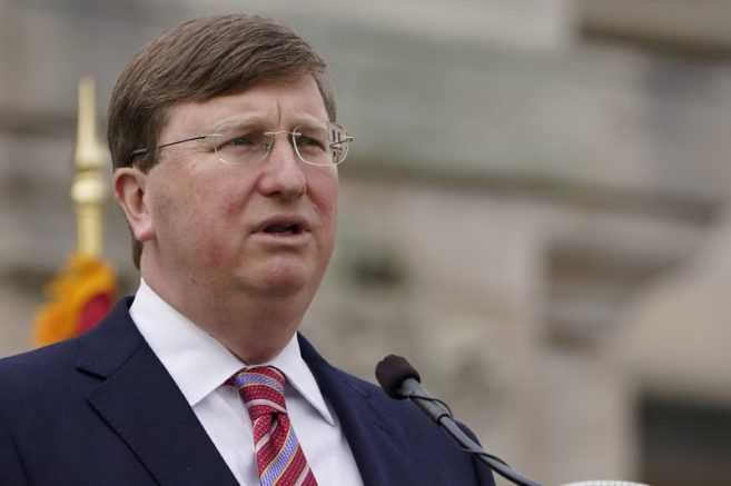Mississippi Gov. Tate Reeves on the south steps of the state Capitol in Jackson, Miss. (AP Photo/Rogelio V. Solis)