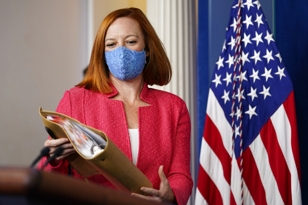 White House press secretary Jen Psaki arrives for the daily briefing at the White House in Washington, Monday, Aug. 23, 2021. (AP Photo/Susan Walsh)