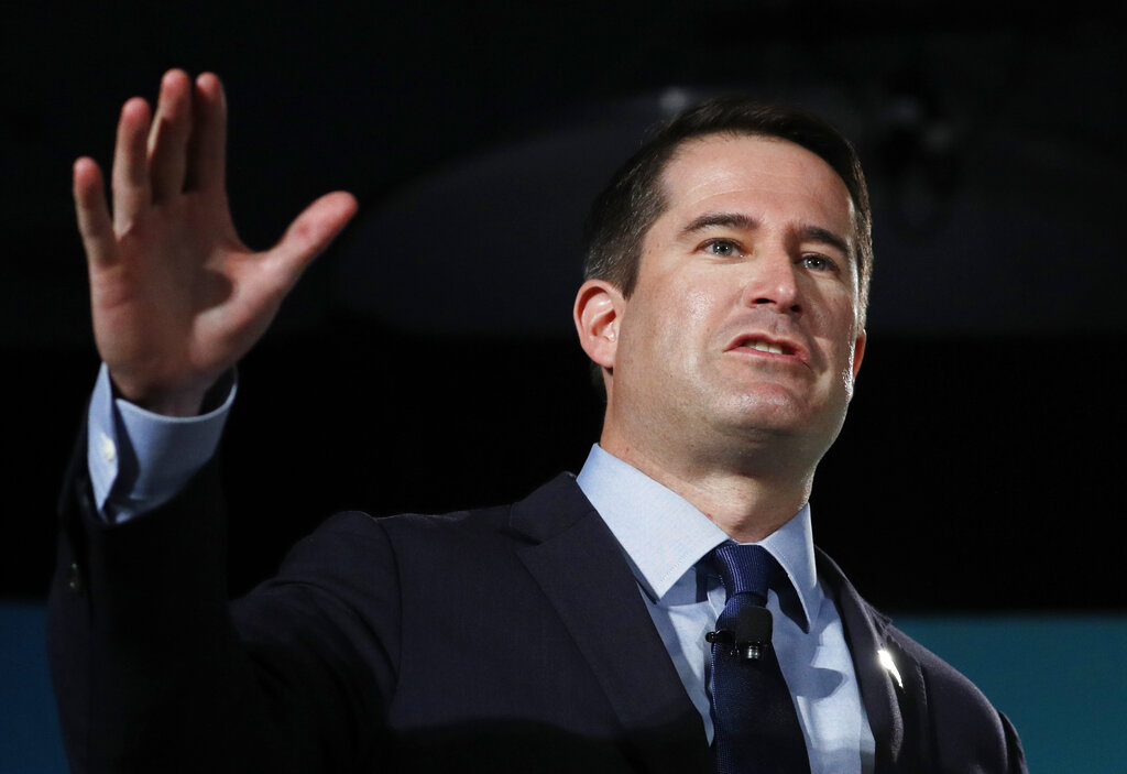 FILE - Democratic presidential candidate Rep. Seth Moulton, D-Mass., speaks during a candidate forum on labor issues on Aug. 3, 2019, in Las Vegas. Moulton and Michigan Republican congressman Peter Meijerflew flew unannounced into Kabul airport in the middle of the ongoing chaotic evacuation Tuesday, Aug. 24, 2021, stunning State Department and U.S. military personnel who had to divert resources to provide security and information to the lawmakers, U.S. officials said. (AP Photo/John Locher, File)