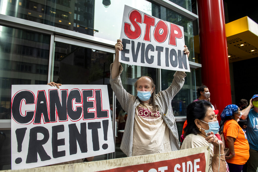 FILE - In this Aug. 4, 2021, file photo, housing advocates protest on the eviction moratorium in New York. The Supreme Court is allowing evictions to resume across the United States, blocking the Biden administration from enforcing a temporary ban that was put in place because of the coronavirus pandemic. Roughly 3.5 million people in the United States said they faced eviction in the next two months, according to Census Bureau data from early August. (AP Photo/Brittainy Newman, File)