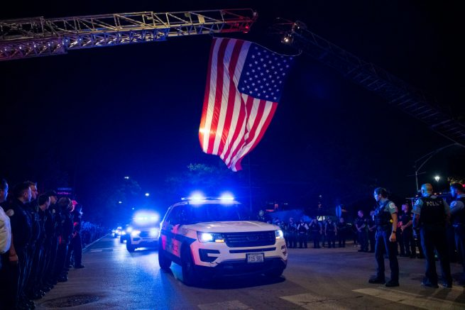 A Chicago police procession for the body of Officer French as it was driven to Cook County Medical Examiners Office on August 8, 2021. (Tyler LaRiviere/Chicago Sun-Times via AP)