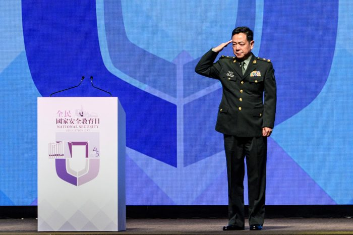 Commander of the Chinese People's Liberation Army Hong Kong Garrison, Major General Chen Daoxiang salutes before delivering a speech during the National Security Education Day Opening Ceremony at the Hong Kong Convention Centre in Hong Kong. (Photo by ANTHONY WALLACE/AFP via Getty Images)