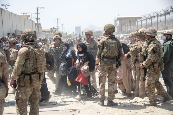 In this handout image provided by the Ministry of Defence, the British armed forces work with the U.S. military to evacuate eligible civilians and their families out of the country on August 21, 2021 in Kabul, Afghanistan. (Photo by MoD Crown Copyright via Getty Images)