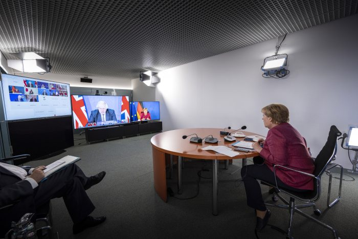 In this handout photo provided by the German Government Press Office (BPA), German Chancellor Angela Merkel attends a virtual G7 meeting, hosted by British Prime Minister Boris Johnson, on August 24, 2021 in Berlin, Germany. (Photo by Guido Bergmann/Bundesregierung via Getty Images)