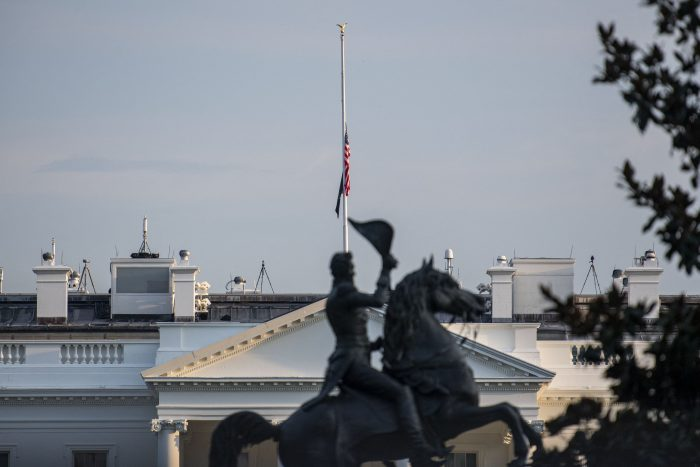The U.S. flag flies at half mast over the White House after Joe Biden delivered remarks on the terror attack at Hamid Karzai International Airport, and the US service members and Afghan victims killed and wounded, in Washington, D.C. (Photo by ERIC BARADAT/AFP via Getty Images)