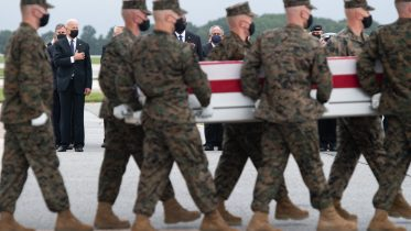 Joe Biden, left, attends the dignified transfer of the remains of fallen service members at Dover Air Force Base in Dover, Delaware, August, 29, 2021, after 13 members of the U.S. military were killed in Afghanistan last week.(Photo by SAUL LOEB / AFP) (Photo by SAUL LOEB/AFP via Getty Images)