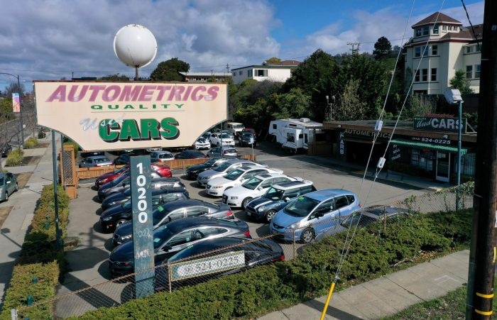 Used cars sit on the sales lot at Autometrics Quality Used Cars in El Cerrito, California. (Photo by Justin Sullivan/Getty Images)