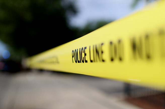 FILE – Police tape surrounds a crime scene. (Photo by Scott Olson/Getty Images)