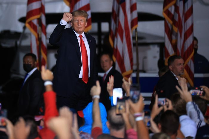 """President Donald Trump pumps his fist as he finishes addressing a """"Save America"""" rally at York Family Farms in Cullman, Alabama. (Photo by Chip Somodevilla/Getty Images)"""