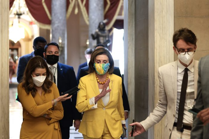 House Speaker Nancy Pelosi (D-Calif.) speaks to a reporter as she walks to her office at the U.S. Capitol in Washington, D.C. (Photo by Anna Moneymaker/Getty Images
