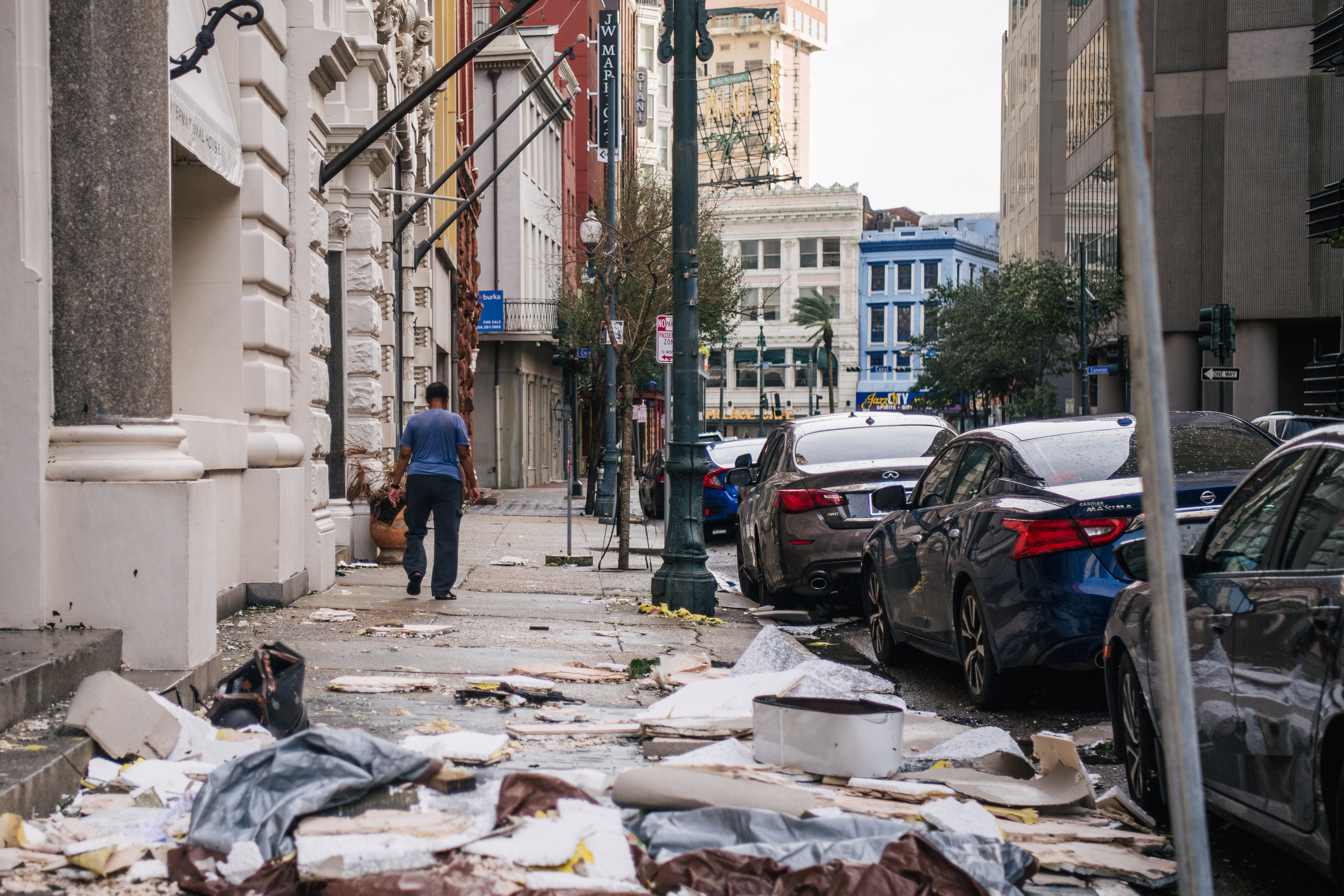 A person walks past debris on the sidewalk after Hurricane Ida passed through on August 30, 2021 in New Orleans, Louisiana. (Photo by Brandon Bell/Getty Images)