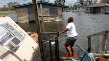 Dina Lewis rescues items from her home after it was destroyed by Hurricane Ida on August 30, 2021 in Laplace, Louisiana. (Photo by Scott Olson/Getty Images)