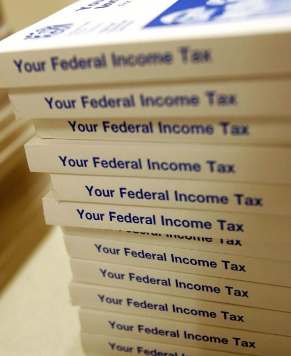 Federal income tax information books are seen at the Des Plaines Public Library in Des Plaines, Illinois. (Photo by Tim Boyle/Getty Images)