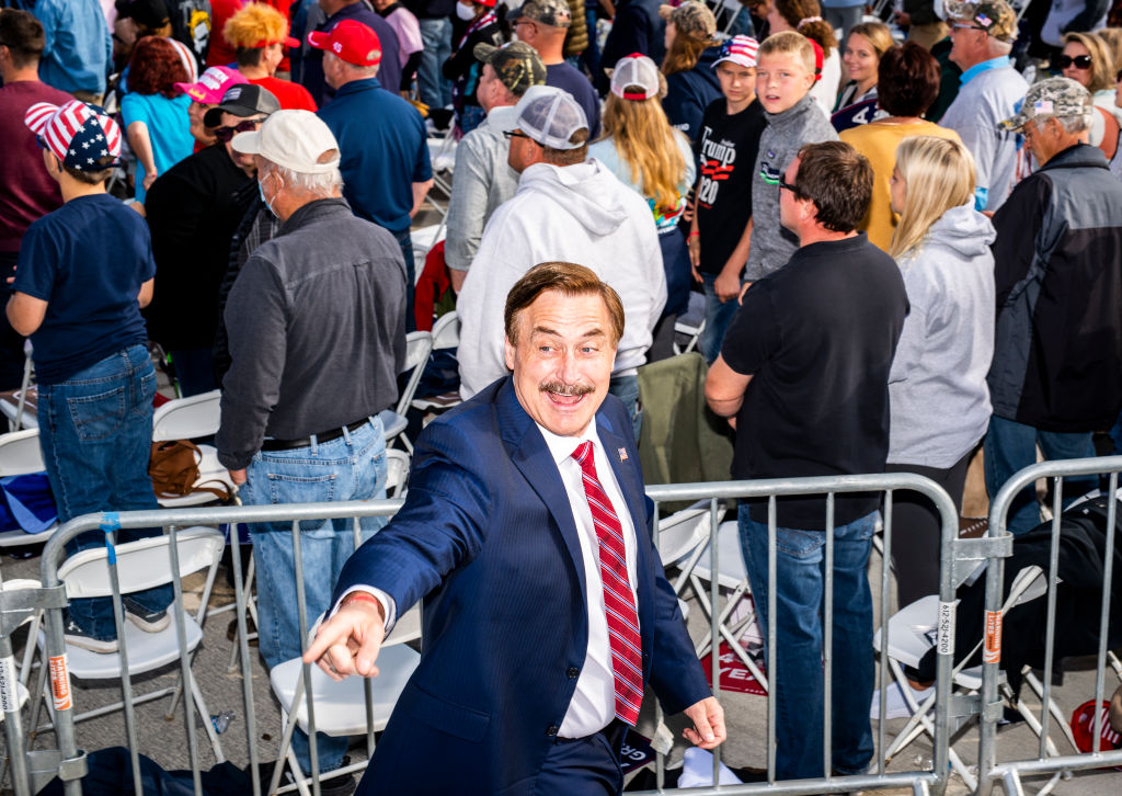 BEMIDJI, MN - SEPTEMBER 18: Mike Lindell (L), founder of My Pillow Inc., points to the crowd during a rally for President Donald Trump at the Bemidji Regional Airport on September 18, 2020 in Bemidji, Minnesota. Trump and challenger, Democratic presidential nominee and former Vice President Joe Biden, are both campaigning in Minnesota today. (Photo by Stephen Maturen/Getty Images)