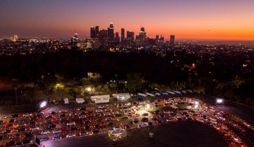 TOPSHOT - This aerial view shows cars lined up at the Dodger Stadium parking lot for Covid-19 testing with the downtown Los Angeles skyline in the distance, in Los Angeles, California, on November 14, 2020. - After California passed 1 million coronavirus cases a travel advisory was issued on November 13 urging a two-week quarantine for those arriving from other states or countries. (Photo by Robyn Beck / AFP) (Photo by ROBYN BECK/AFP via Getty Images)