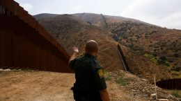 TOPSHOT - A US Border Patrol agent shows an incomplete section of the new steel bollard-style border wall on a hillside along the US-Mexico border between San Diego and Tijuana, during a tour with the US Customs and Border Protection on May 10, 2021 in the Otay Mesa area of San Diego County, California. - Few issues have as long a history of bedeviling both Democrats and Republicans as immigration and asylum on the approximately 2,000-mile (3,000-kilometer) US-Mexico frontier. (Photo by Patrick T. FALLON / AFP) (Photo by PATRICK T. FALLON/AFP via Getty Images)