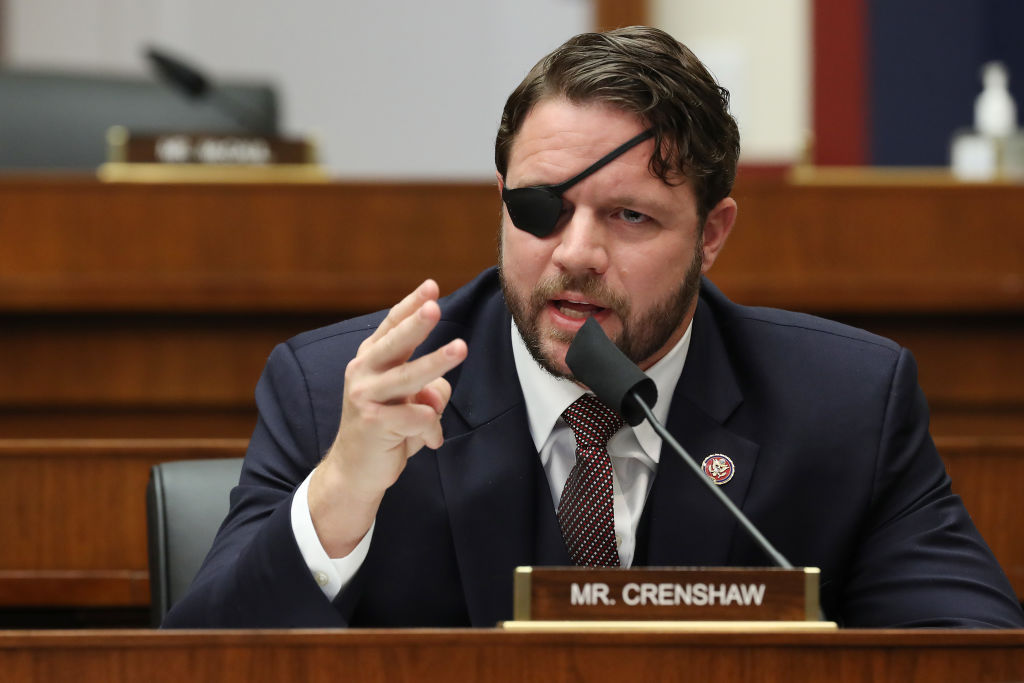 """US Representative Dan Crenshaw questions witnesses during a House Homeland Security Committee hearing about """"Worldwide threats to the Homeland"""" on Capitol Hill on September 17, 2020 in Washington, DC. (Photo by Chip Somodevilla / POOL / AFP) (Photo by CHIP SOMODEVILLA/POOL/AFP via Getty Images)"""