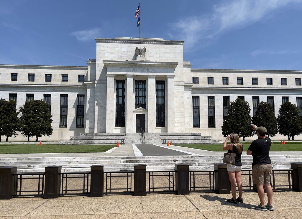 People take pictures of the Federal Reserve building in Washington, DC on August 6, 2021. (Photo by Daniel SLIM / AFP) (Photo by DANIEL SLIM/AFP via Getty Images)