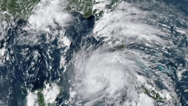 This GOES-16 East GeoColor satellite image taken Friday, Aug. 27, 2021, at 4:40 p.m. EDT, and provided by NOAA, shows Hurricane Ida crossing western Cuba. Hurricane Ida struck Cuba on Friday and threatened to slam into Louisiana with far greater force over the weekend, prompting New Orleans' mayor to order everyone outside the protection of the city's levees to evacuate. (NOAA via AP)