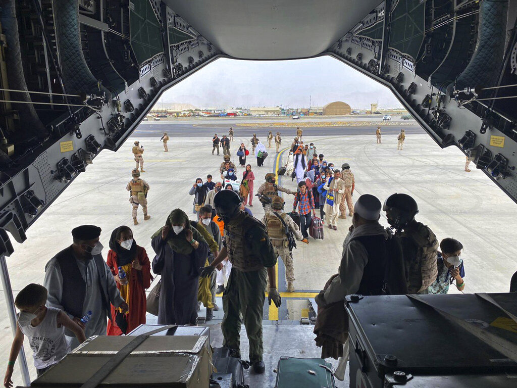 In this photo provided by the Spanish Defence Ministry and taken in Kabul, Afghanistan, people board a Spanish airforce A400 plane as part of an evacuation plan at Kabul airport in Afghanistan, Wednesday Aug. 18, 2021. (Spanish Defence Ministry via AP)