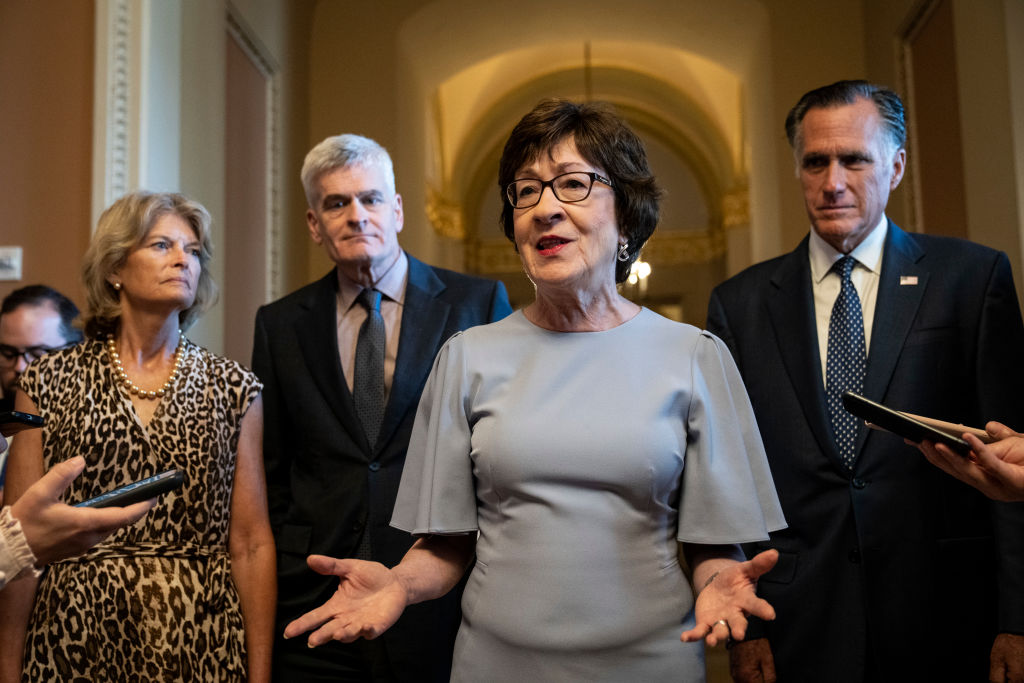 WASHINGTON, DC - JULY 28: The lead GOP negotiators on the bipartisan infrastructure legislation, L-R, Sen. Lisa Murkowski (R-AK), Sen. Bill Cassidy (R-LA), Sen. Susan Collins (R-ME) and Sen. Mitt Romney (R-UT) speak to reporters after meeting privately with Senate Minority Leader Mitch McConnell (R-KY) at the U.S. Capitol on July 28, 2021 in Washington, DC. The group told reporters that they now have an agreement with Senate Democrats on the major issues of the bill. (Photo by Drew Angerer/Getty Images)