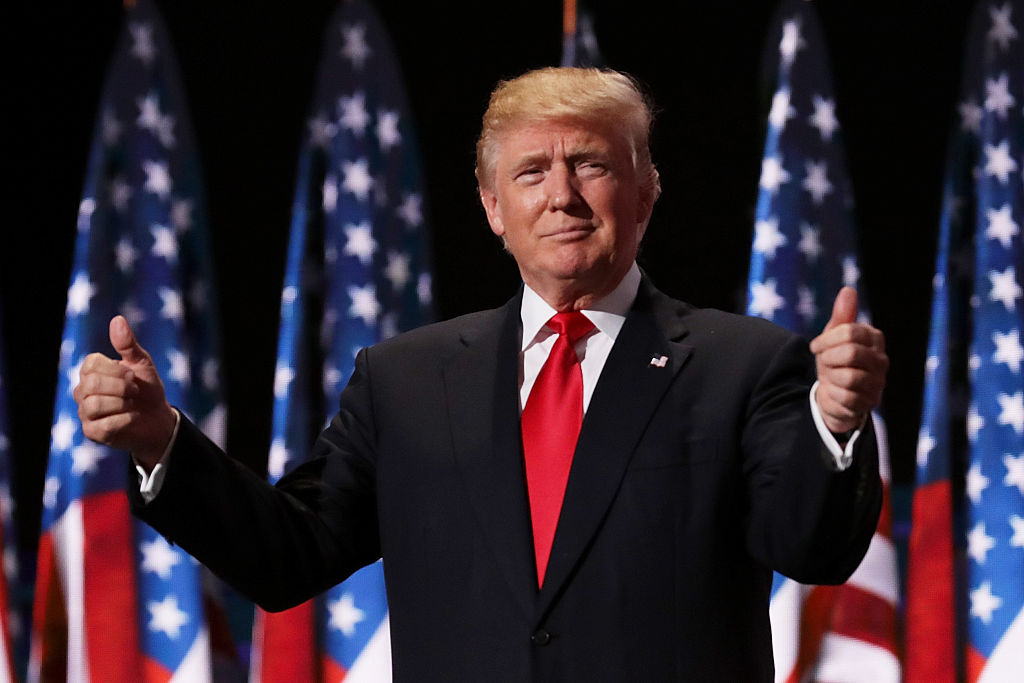 CLEVELAND, OH - JULY 21: Republican presidential candidate Donald Trump gives two thumbs up to the crowd during the evening session on the fourth day of the Republican National Convention on July 21, 2016 at the Quicken Loans Arena in Cleveland, Ohio. Republican presidential candidate Donald Trump received the number of votes needed to secure the party's nomination. An estimated 50,000 people are expected in Cleveland, including hundreds of protesters and members of the media. The four-day Republican National Convention kicked off on July 18. (Photo by Chip Somodevilla/Getty Images)