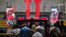 Friends and family pay their respects to Aaron Lowe during a funeral service at Family Cathedral of Praise, Monday, Oct. 11, 2021, in Mesquite, Texas. Lowe, a student and football player at the University of Utah, was was shot and killed on Sept. 26 at a post-game party. (AP Photo/Brandon Wade)