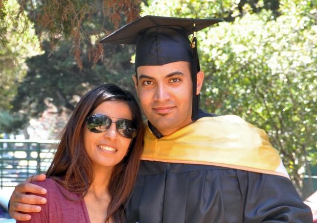 In this photo provided by the family of Abdulrahman al-Sadhan, Abdulrahman al-Sadhan poses with his sister Areej Al Sadhan for a graduation photo, at Notre Dame de Namur University, a private Catholic university, in Belmont, Calif. (Family of Abdulrahman al-Sadhan via AP)