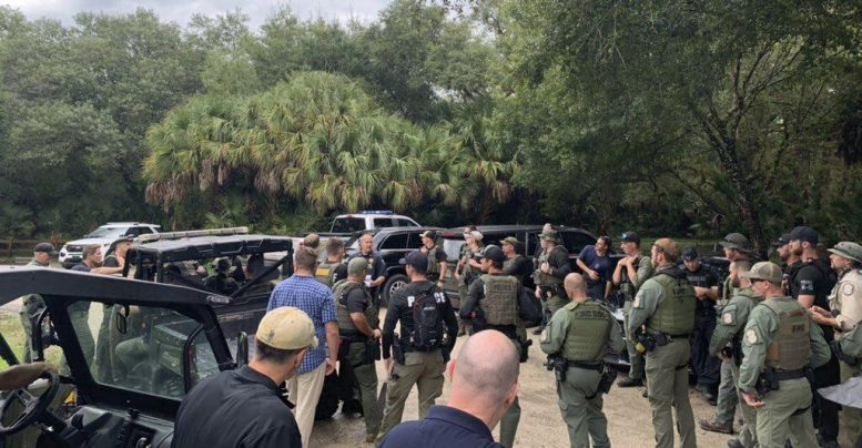 This photo provided by North Port Police Department, law enforcement officials conduct a search of the vast Carlton Reserve in the Sarasota, Fla., area for Brian Laundrie on Saturday, Sept. 18, 2021.(North Port Police Department via AP)