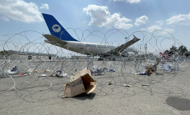 A commercial airplane is seen at the Hamid Karzai International Airport a day after U.S troops withdrawal in Kabul