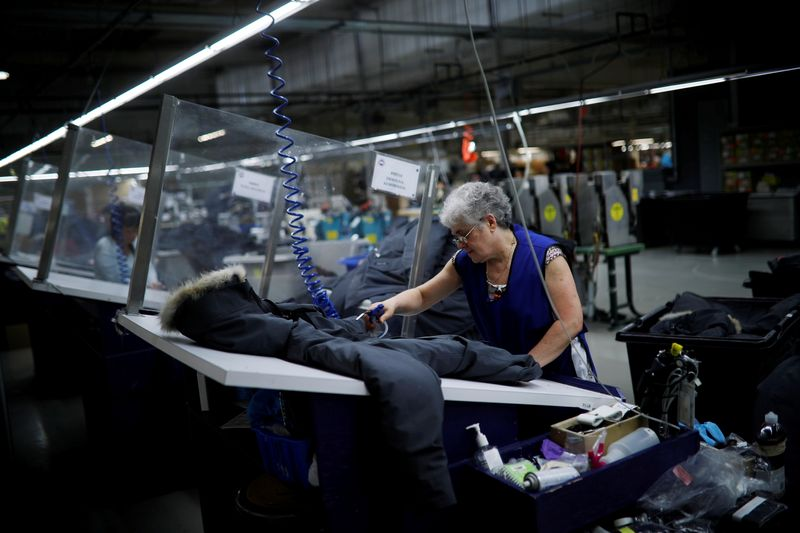 FILE PHOTO: Workers make jackets at the Canada Goose factory in Toronto