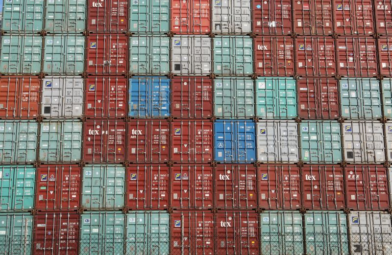 Containers are piled up at Port Botany facilities in Sydney