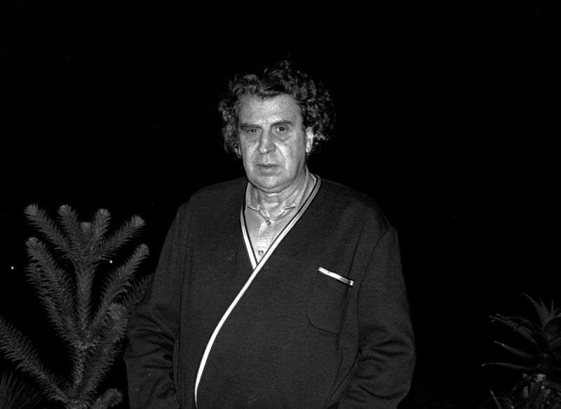 FILE PHOTO: GREEK COMPOSER THEODORAKIS GIVES INTERVIEW TO REUTERS ON BALCONY ACROSS FROM ACROPOLIS IN ATHENS.